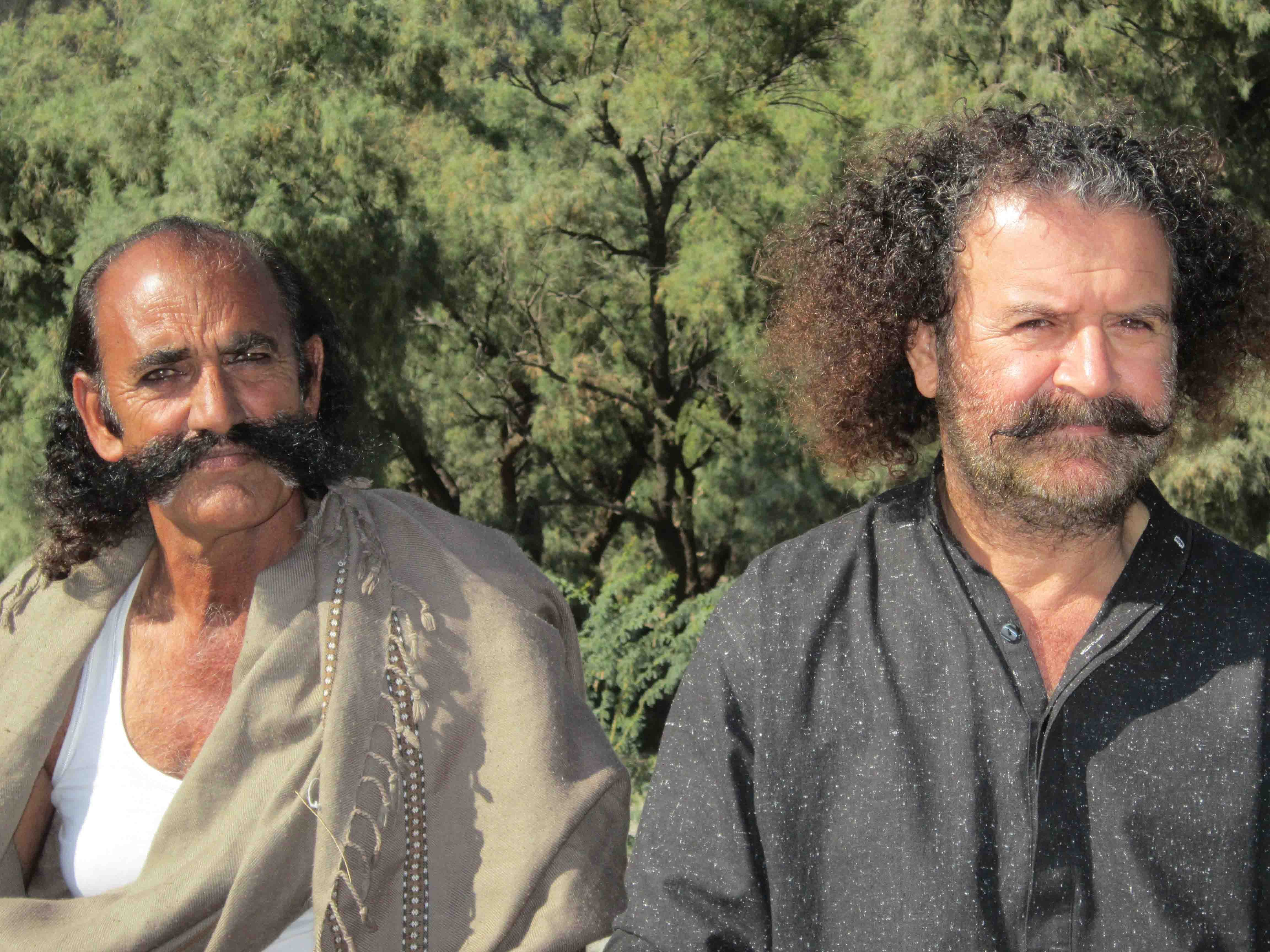 Ayub Khosa as Saien & Rehman His Assistant