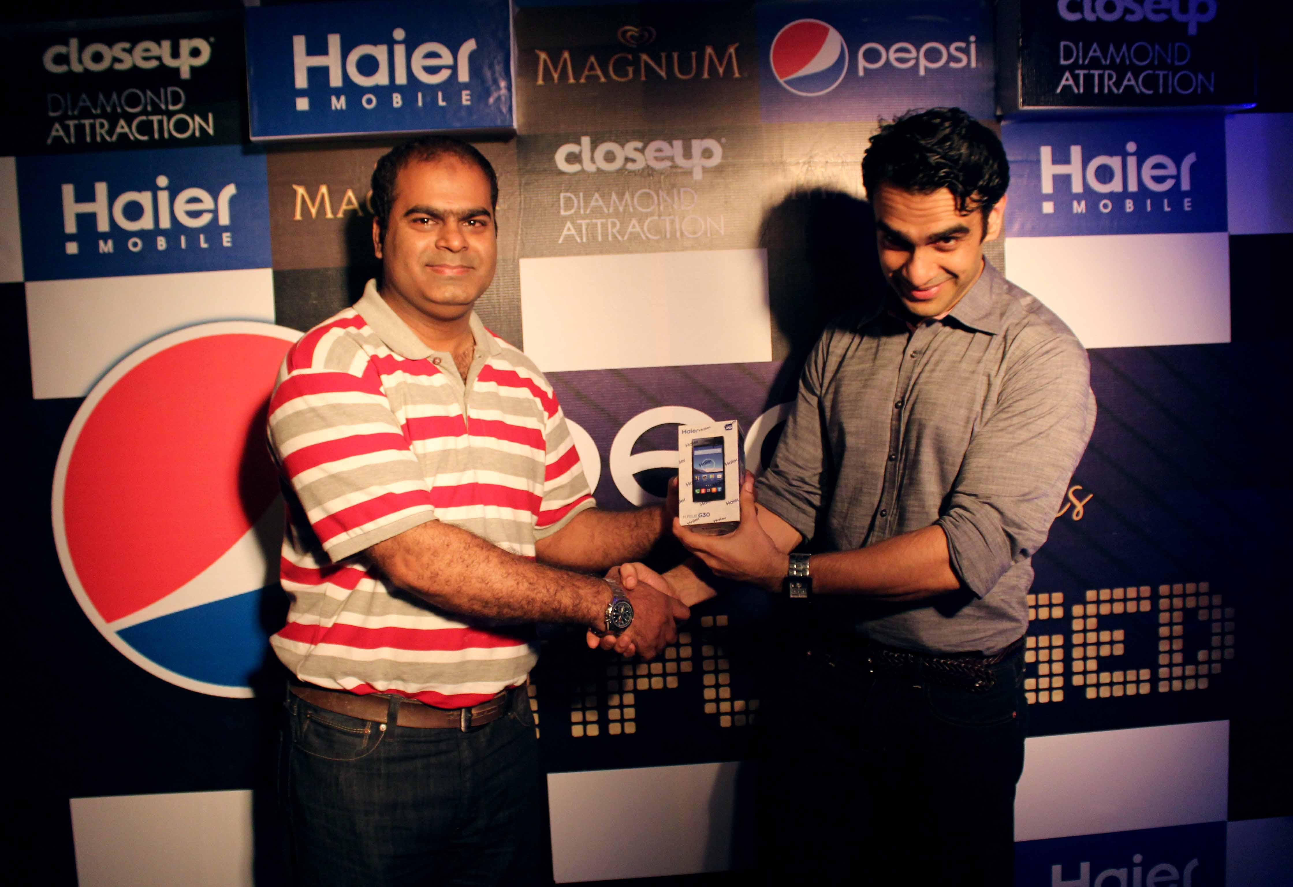 Munib Nawaz receiving Haier Smart phone